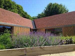 BPitched, tiled roofs completed by Kingsley Roofing at the open air museum in Chichester.