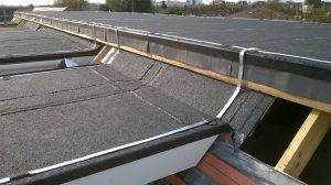 Kingsley Roofing completed a felt roof on this apartment block on Slough. This picture gives an interesting view of the part finished roof and the felt layers